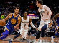 NBA Notes: Warriors' Curry out at least two weeks