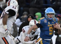 Abey helps Navy sink Virginia in Military Bowl