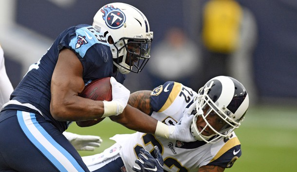 Dec 24 2017 Nashville TN USA Tennessee Titans running back De Marco Murray fights off a tackle attempt by /Los Angeles Rams cornerback Trumaine Johnson during the first half at Nissan Stadium