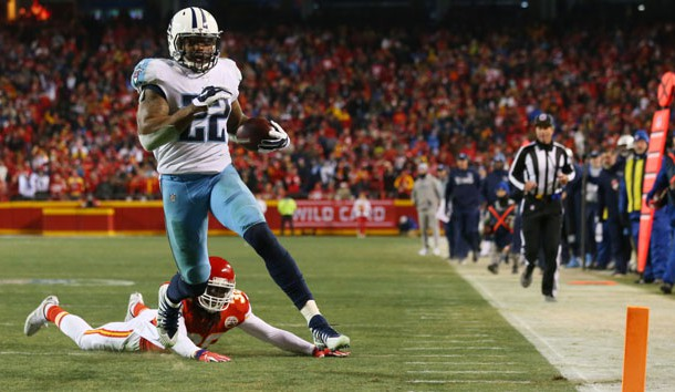 Jan 6, 2018; Kansas City, MO, USA; Tennessee Titans running back Derrick Henry (22) gets past Kansas City Chiefs free safety Ron Parker (38) to score a touchdown in the fourth quarter in the AFC Wild Card playoff football game at Arrowhead Stadium. Photo Credit: Jay Biggerstaff-USA TODAY Sports