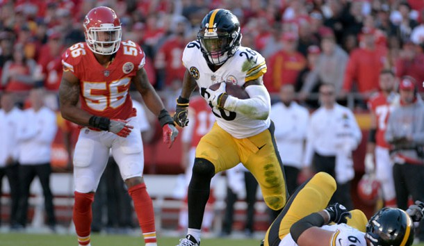 Oct 15 2017 Kansas City MO USA Pittsburgh Steelers running back Le'Veon Bell runs the ball as Kansas City Chiefs inside linebacker Derrick Johnson defends during the first half at Arrowhead Stadium
