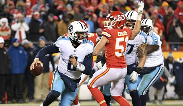 Jan 6, 2018; Kansas City, MO, USA; Tennessee Titans quarterback Marcus Mariota (8) scrambles away from Kansas City Chiefs outside linebacker Frank Zombo (51) during the fourth quarter in the AFC Wild Card playoff football game at Arrowhead Stadium. Photo Credit: Denny Medley-USA TODAY Sports
