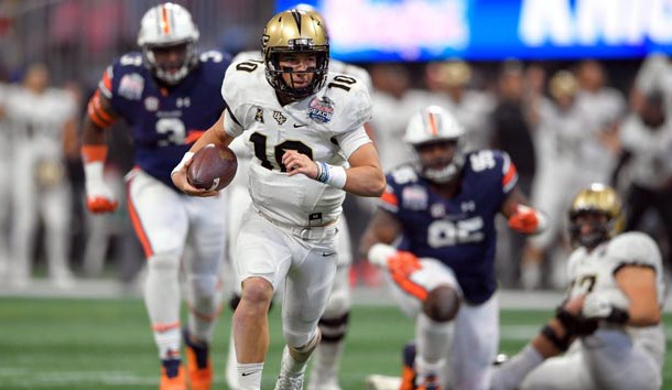 Jan 1, 2018; Atlanta, GA, USA; Central Florida Knights quarterback McKenzie Milton (10) runs for a touchdown against the Auburn Tigers during the first half at Mercedes-Benz Stadium. Photo Credit: Dale Zanine-USA TODAY Sports