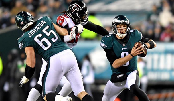 Jan 13, 2018; Philadelphia, PA, USA; Philadelphia Eagles quarterback Nick Foles (9) runs the ball against Atlanta Falcons defensive end Takkarist McKinley (98) during the second quarter in the NFC Divisional playoff game at Lincoln Financial Field. Photo Credit: James Lang-USA TODAY Sports