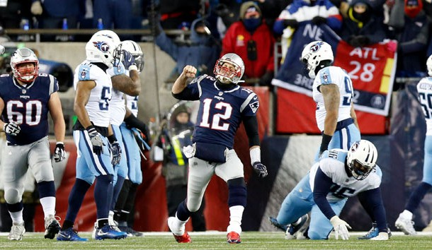 Jan 13, 2018; Foxborough, MA, USA; New England Patriots quarterback Tom Brady (12) celebrates throwing a touchdown pass against the Tennessee Titans during the third quarter of the AFC Divisional playoff game at Gillette Stadium. Photo Credit: Greg M. Cooper-USA TODAY Sports