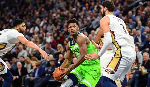 Feb 3, 2018; Minneapolis, MN, USA; Minnesota Timberwolves guard Jimmy Butler (23) goes to the basket as New Orleans Pelicans forward Nikola Mirotic (3) and forward Anthony Davis (23) defend during the second half at Target Center. The Timberwolves won 118-107. Photo Credit: Jeffrey Becker-USA TODAY Sports