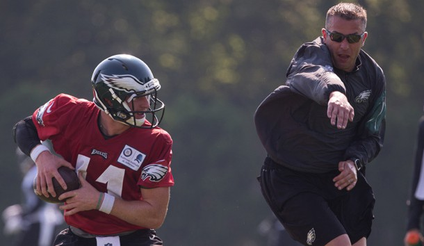 Jun 13, 2017; Philadelphia, PA, USA; Philadelphia Eagles quarterbacks coach John DeFilippo drills with quarterback Carson Wentz (11) during mini camp at NovaCare Complex. Photo Credit: Bill Streicher-USA TODAY Sports
