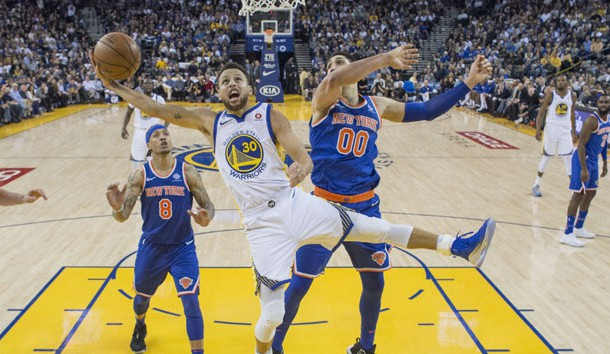 January 23, 2018; Oakland, CA, USA; Golden State Warriors guard Stephen Curry (30) shoots the basketball against New York Knicks center Enes Kanter (00) during the second half at Oracle Arena. The Warriors defeated the Knicks 123-112. Photo Credit: Kyle Terada-USA TODAY Sports