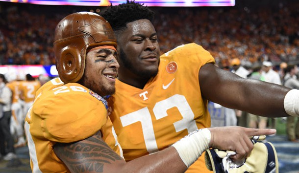 Sep 4, 2017; Atlanta, GA, USA; Tennessee Volunteers linebacker Cortez McDowell (20) wears the old leather helmet as he and offensive lineman Trey Smith (73) react after defeating the Georgia Tech Yellow Jackets at Mercedes-Benz Stadium. Tennessee won 42-41 in two overtimes. Photo Credit: Dale Zanine-USA TODAY Sports