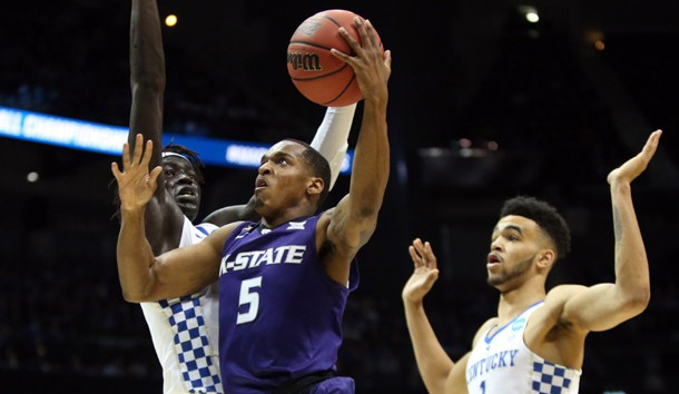 Mar 22, 2018; Atlanta, GA, USA; Kansas State Wildcats guard Barry Brown (5) drives to the basket against Kentucky Wildcats forward Wenyen Gabriel (32) and forward Sacha Killeya-Jones (1) during the first half in the semifinals of the South regional of the 2018 NCAA Tournament at Philips Arena. Photo Credit: Brett Davis-USA TODAY Sports