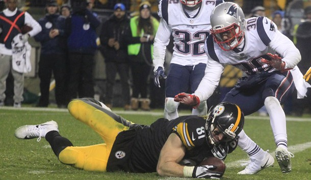 Dec 17, 2017; Pittsburgh, PA, USA;  Pittsburgh Steelers tight end Jesse James (81) fails to hold the ball as he falls across the goal line against New England Patriots free safety Devin McCourty (32) and strong safety Duron Harmon (30) during the fourth quarter at Heinz Field. The play was ruled an incomplete pass. The Patriots won 27-24. Photo Credit: Charles LeClaire-USA TODAY Sports