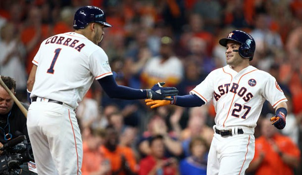Oct 5, 2017; Houston, TX, USA; Houston Astros second baseman Jose Altuve (27) celebrates with shortstop Carlos Correa (1) after hitting a home run during the seventh inning against the Boston Red Sox in game one of the 2017 ALDS playoff baseball series at Minute Maid Park. Photo Credit: Troy Taormina-USA TODAY Sports