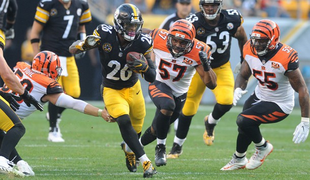 Oct 22, 2017; Pittsburgh, PA, USA; Pittsburgh Steelers runningback Le'Veon Bell (26) runs for a first down as Cincinnati Bengals linebacker Nick Vigil (59) and linebacker Vincent Rey (57) give chase in the second quarter at Heinz Field. Photo Credit: Philip G. Pavely-USA TODAY Sports