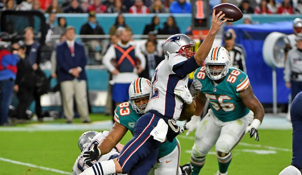 Dec 11, 2017; Miami Gardens, FL, USA; Miami Dolphins defensive tackle Ndamukong Suh (93) pressures New England Patriots quarterback Tom Brady (12) during the second half at Hard Rock Stadium. Photo Credit: Jasen Vinlove-USA TODAY Sports
