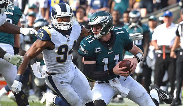 The Miami Dolphins trade for Rams defensive end Robert Quinn
