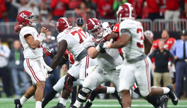 Jan 8, 2018; Atlanta, GA, USA; Alabama Crimson Tide quarterback Tua Tagovailoa (13) throws the game-winning touchdown pass to wide receiver DeVonta Smith (not pictured) in overtime against the Georgia Bulldogs in the 2018 CFP national championship college football game at Mercedes-Benz Stadium. Photo Credit: Mark J. Rebilas-USA TODAY Sports