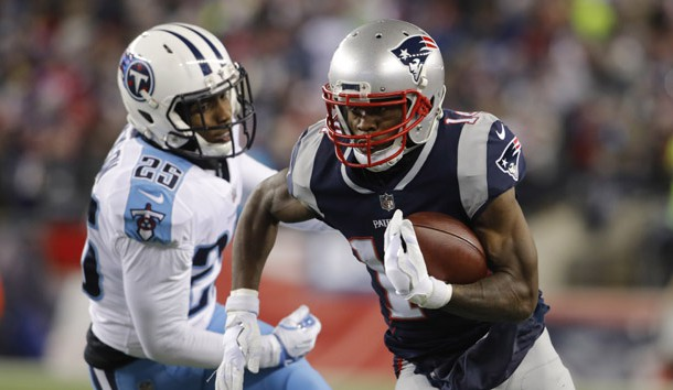 Jan 13, 2018; Foxborough, MA, USA; New England Patriots wide receiver Brandin Cooks (14) runs the ball against Tennessee Titans cornerback Adoree' Jackson (25) during the second quarter in the AFC Divisional playoff game at Gillette Stadium. Photo Credit: David Butler II-USA TODAY Sports