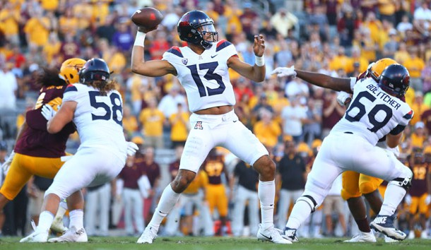 Nov 25, 2017; Tempe, AZ, USA; Arizona Wildcats quarterback Brandon Dawkins (13) throws a pass in the third quarter against the Arizona State Sun Devils during the Territorial Cup at Sun Devil Stadium. Photo Credit: Mark J. Rebilas-USA TODAY Sports