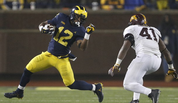 Nov 4, 2017; Ann Arbor, MI, USA; Michigan Wolverines running back Chris Evans (12) runs the ball against Minnesota Golden Gophers linebacker Thomas Barber (41) during the fourth quarter at Michigan Stadium. Photo Credit: Raj Mehta-USA TODAY Sports