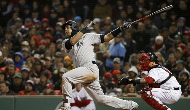 Apr 11, 2018; Boston, MA, USA; New York Yankees catcher Gary Sanchez (24) follows through on his second two-run home run of the game during the fourth inning against the Boston Red Sox at Fenway Park. Photo Credit: Winslow Townson-USA TODAY Sports