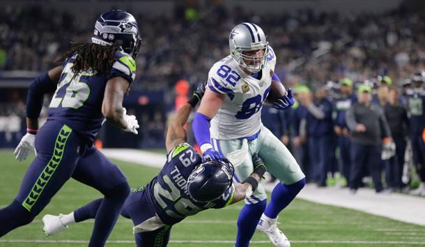 Dec 24, 2017; Arlington, TX, USA; Dallas Cowboys tight end Jason Witten (82) runs over Seattle Seahawks free safety Earl Thomas (29) at AT&T Stadium. Seattle won 21-12. Photo Credit: Erich Schlegel-USA TODAY Sports