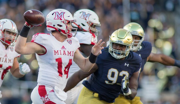 Sep 30, 2017; South Bend, IN, USA; Miami (Oh) Redhawks quarterback Gus Ragland (14) passes the ball as Notre Dame Fighting Irish defensive lineman Jay Hayes (93) defends in the first half  at Notre Dame Stadium. Photo Credit: Trevor Ruszkowski-USA TODAY Sports