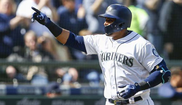 Mar 31, 2018; Seattle, WA, USA; Seattle Mariners designated hitter Nelson Cruz (23) points to the stands after hitting a two-run homer against the Cleveland Indians during the sixth inning at Safeco Field. Photo Credit: Joe Nicholson-USA TODAY Sports