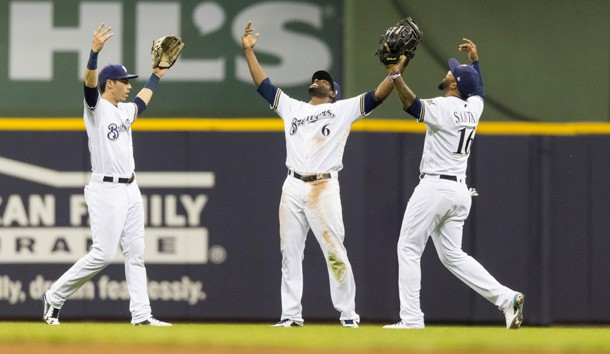 May 22, 2018; Milwaukee, WI, USA; Milwaukee Brewers outfielders Christian Yelich (22) and Lorenzo Cain (6) and Domingo Santana (16) celebrate following the game against the Arizona Diamondbacks at Miller Park. Photo Credit: Jeff Hanisch-USA TODAY Sports