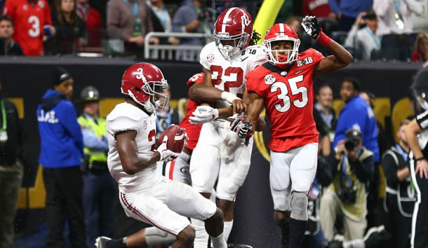 Jan 8, 2018; Atlanta, GA, USA; Alabama Crimson Tide wide receiver Calvin Ridley (3) catches a touchdown pass against Georgia Bulldogs defensive back Aaron Davis (35) during the fourth quarter in the 2018 CFP national championship college football game at Mercedes-Benz Stadium. Photo Credit: Mark J. Rebilas-USA TODAY Sports