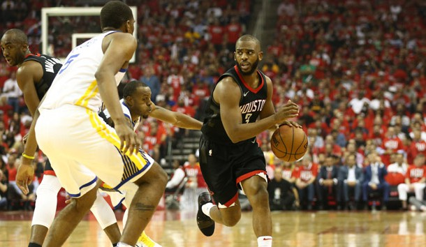 May 14, 2018; Houston, TX, USA; Houston Rockets guard Chris Paul (3) dribbles against Golden State Warriors forward Kevon Looney (5) during the second quarter in game one of the Western conference finals of the 2018 NBA Playoffs at Toyota Center. Photo Credit: Troy Taormina-USA TODAY Sports