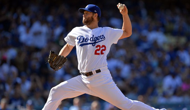 March 29, 2018; Los Angeles, CA, USA; Los Angeles Dodgers starting pitcher Clayton Kershaw (22) throws against the San Francisco Giants in the first inning of the opening day game at Dodger Stadium. Photo Credit: Gary A. Vasquez-USA TODAY Sports