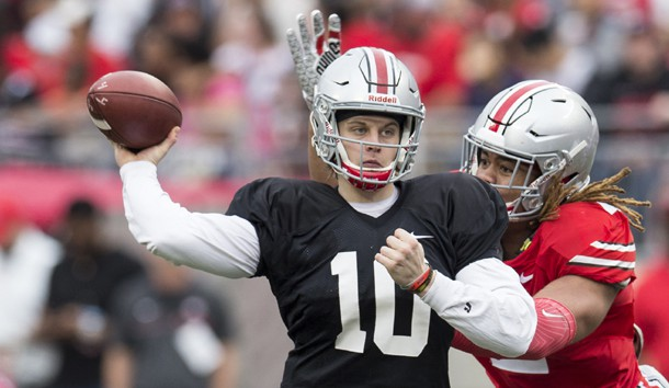 Apr 14, 2018; Columbus, OH, USA;Gray Team quarterback Joe Burrow (10) sends a pass upfield under pressure from Scarlet Team defensive end Chase Young (2) during the Spring Game at Ohio Stadium. Photo Credit: Greg Bartram-USA TODAY Sports