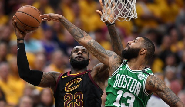May 21, 2018; Cleveland, OH, USA; Cleveland Cavaliers forward LeBron James (23) attempts a layup in front of Boston Celtics forward Marcus Morris (13) during the third quarter in game four of the Eastern conference finals of the 2018 NBA Playoffs at Quicken Loans Arena. Photo Credit: Ken Blaze-USA TODAY Sports