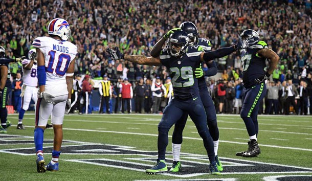 Nov 7, 2016; Seattle, WA, USA; Seattle Seahawks safety Earl Thomas (29) celebrates with safety Kelcie McCray (33) after a Buffalo Bills incomplete pass on fourth down with 13 seconds left as Bills receiver Robert Woods (10) reacts during a NFL football game at CenturyLink Field. The Seahawks defeated the Bills 31-25. Photo Credit: Kirby Lee-USA TODAY Sports
