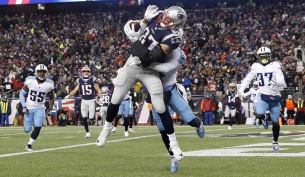 Jan 13, 2018; Foxborough, MA, USA; New England Patriots tight end Rob Gronkowski (87) makes a touchdown  catch against Tennessee Titans free safety Kevin Byard (31) during the fourth quarter in the AFC Divisional playoff game at Gillette Stadium. Photo Credit: Winslow Townson-USA TODAY Sports