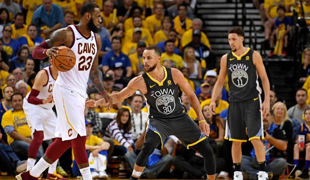 June 3, 2018; Oakland, CA, USA; Cleveland Cavaliers forward LeBron James (23) handles the ball against Golden State Warriors guard Stephen Curry (30) during the fourth quarter in game two of the 2018 NBA Finals at Oracle Arena. Photo Credit: Kyle Terada-USA TODAY Sports