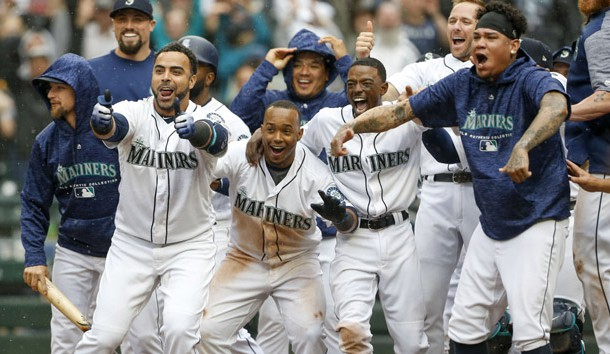 Jun 13, 2018; Seattle, WA, USA; Seattle Mariners designated hitter Nelson Cruz (23, left), shortstop Jean Segura (2), second baseman Dee Gordon (9) and starting pitcher Felix Hernandez (34, right) wait at home plate following a walk-off two-run homer by right fielder Mitch Haniger (17, not pictured) against the Los Angeles Angels during the ninth inning at Safeco Field. Segura scored on the hit. Seattle defeated Los Angeles, 8-6. Photo Credit: Joe Nicholson-USA TODAY Sports