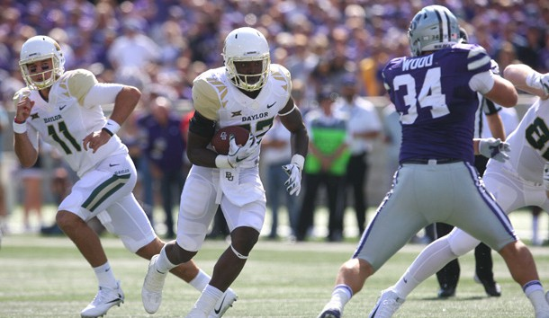 Sep 30, 2017; Manhattan, KS, USA; Baylor Bears running back Terence Williams (22) looks for room to run against Kansas State Wildcats defensive end Tanner Wood (34) during first quarter action at Bill Snyder Family Stadium. Photo Credit: Scott Sewell-USA TODAY Sports