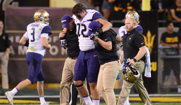 Oct 14, 2017; Tempe, AZ, USA; Washington Huskies offensive lineman Trey Adams (72) is helped off the field after being injured against the Arizona State Sun Devils during the first half at Sun Devil Stadium. Photo Credit: Joe Camporeale-USA TODAY Sports