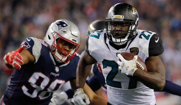 Jan 21, 2018; Foxborough, MA, USA; Jacksonville Jaguars running back Leonard Fournette (27) runs the ball against the New England Patriots in the AFC Championship Game at Gillette Stadium. Photo Credit: David Butler II-USA TODAY Sports