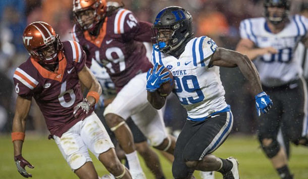 Oct 28, 2017; Blacksburg, VA, USA; Duke Blue Devils running back Shaun Wilson (29) runs the ball in the second period as Virginia Tech Hokies defensive back Mook reynolds chases play at Lane Stadium. Photo Credit: Lee Luther Jr.-USA TODAY Sports