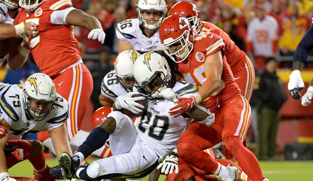 Dec 16, 2017; Kansas City, MO, USA; Los Angeles Chargers running back Melvin Gordon (28) runs the ball and is tackled by Kansas City Chiefs strong safety Daniel Sorensen (49) during the first half at Arrowhead Stadium. Mandatory Credit: Denny Medley-USA TODAY Sports