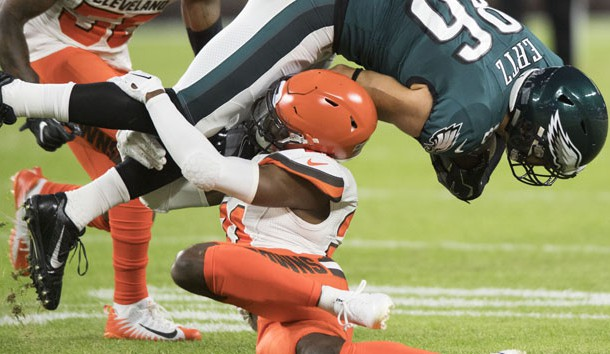 Aug 23, 2018; Cleveland, OH, USA; Cleveland Browns cornerback Denzel Ward (21) tackles Philadelphia Eagles tight end Zach Ertz (86) during the first quarter at FirstEnergy Stadium. Ward was injured on the play. Photo Credit: Ken Blaze-USA TODAY Sports