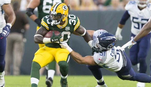 Aug 9, 2018; Green Bay, WI, USA; Green Bay Packers running back Jamaal Williams (30) is tackled by Tennessee Titans linebacker Will Compton (51) during the second quarter at Lambeau Field. Photo Credit: Jeff Hanisch-USA TODAY Sports