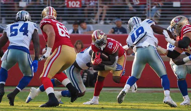 Aug 9, 2018; Santa Clara, CA, USA; San Francisco 49ers running back Jerick McKinnon (28) is brought down against the Dallas Cowboys during the first quarter at Levi's Stadium. Photo Credit: Kelley L Cox-USA TODAY Sports