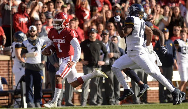 Nov 25, 2017; Norman, OK, USA; Oklahoma Sooners quarterback Kyler Murray (1) runs for a long gain in front of West Virginia Mountaineers cornerback Elijah Battle (19) during the first quarter at Gaylord Family - Oklahoma Memorial Stadium. Photo Credit: Mark D. Smith-USA TODAY Sports