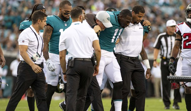 Aug 25, 2018; Jacksonville, FL, USA; Jacksonville Jaguars wide receiver Marqise Lee (11) is helped to a cart after suffering an apparent injury during the first half against the Atlanta Falcons at TIAA Bank Field. Photo Credit: Douglas DeFelice-USA TODAY Sports