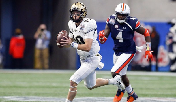 Jan 1, 2018; Atlanta, GA, USA; Central Florida Knights quarterback McKenzie Milton (10) throws a pass against the Auburn Tigers in the third quarter in the 2018 Peach Bowl at Mercedes-Benz Stadium. Photo Credit: Brett Davis-USA TODAY Sports