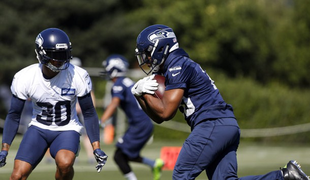 Jul 26, 2018; Renton, WA, USA; Seattle Seahawks running back Rashaad Penny (20) rushes against strong safety Bradley McDougald (30) during a training camp practice at the Virginia Mason Athletic Center. Photo Credit: Joe Nicholson-USA TODAY Sports