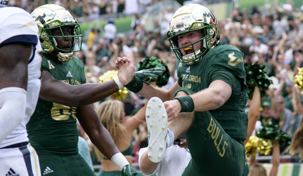 Sep 8, 2018; Tampa, FL, USA; South Florida quarterback Blake Barnett (11) celebrates his touchdown with his teammates during the second half against the Georgia Tech Yellow Jackets at Raymond James Stadium. Photo Credit: Douglas DeFelice-USA TODAY Sports